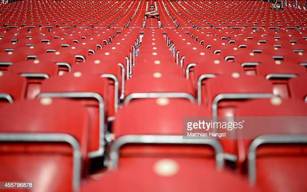 A fan of Mainz sits on the tribune priot to the Bundesliga match between 1 FSV Mainz 05 and Borussia Dortmund at Coface Arena on September 20 2014 in...