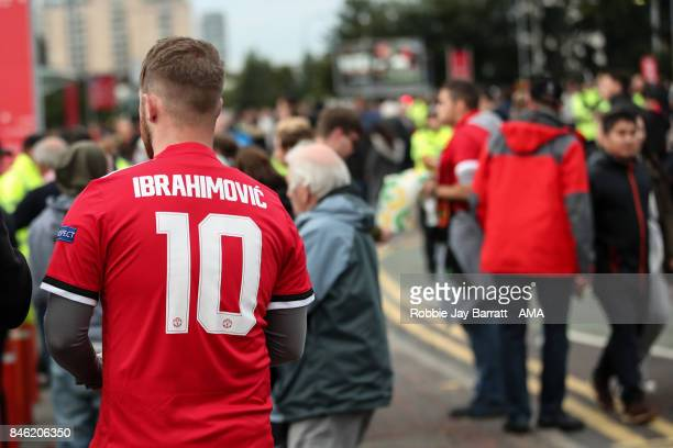 A fan of Manchester United wears a Zlatan Ibrahimovic of Manchester United shirt prior to the UEFA Champions League match between Manchester United...