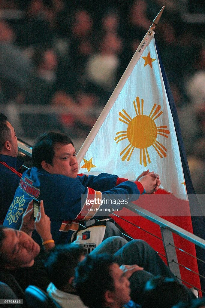 A fan of Manny Pacquiao of the Philippines waits for Pacquiao to take on Joshua Clottey of Ghana before the WBO welterweight title fight at Cowboys Stadium on March 13, 2010 in Arlington, Texas. Pacquiao defeated Clottey by unanimous decision.