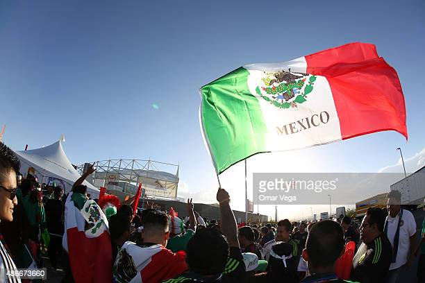 A fan of Mexico waves a flag prior a friendly match between Mexico and Trinidad and Tobago at Rio Tinto Stadium on September 04 2015 in Sandy Utah