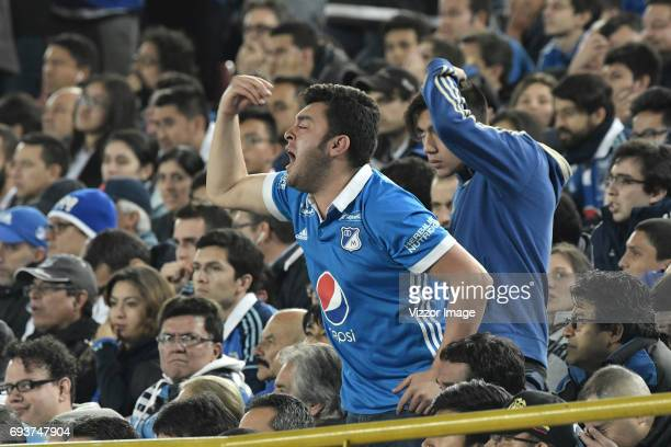 A fan of Millonarios cheers for his team during the Semi Finals first leg match between Millonarios and Atletico Nacional as part of Liga Aguila I...