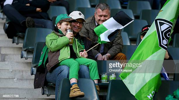A fan of Moenchengladbach waves a flag during the Regionalliga West match between Borussia Moenchengladbach II and Rot Weiss Essen at Borussiapark on...