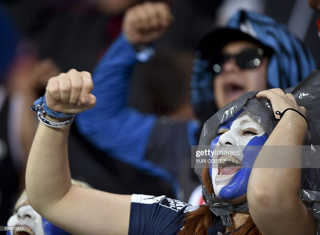 A Monterrey's fan cheers for her team before the Mexican Clausura tournament first leg final football match againts Pachuca at the Hidalgo stadium in Pachuca on May 26, 2016. / AFP / YURI