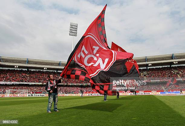 A fan of Nuernberg waves a flag to support his team before the Bundesliga match between 1 FC Nuernberg and 1 FC Koeln at Easy Credit Stadium on May 8...
