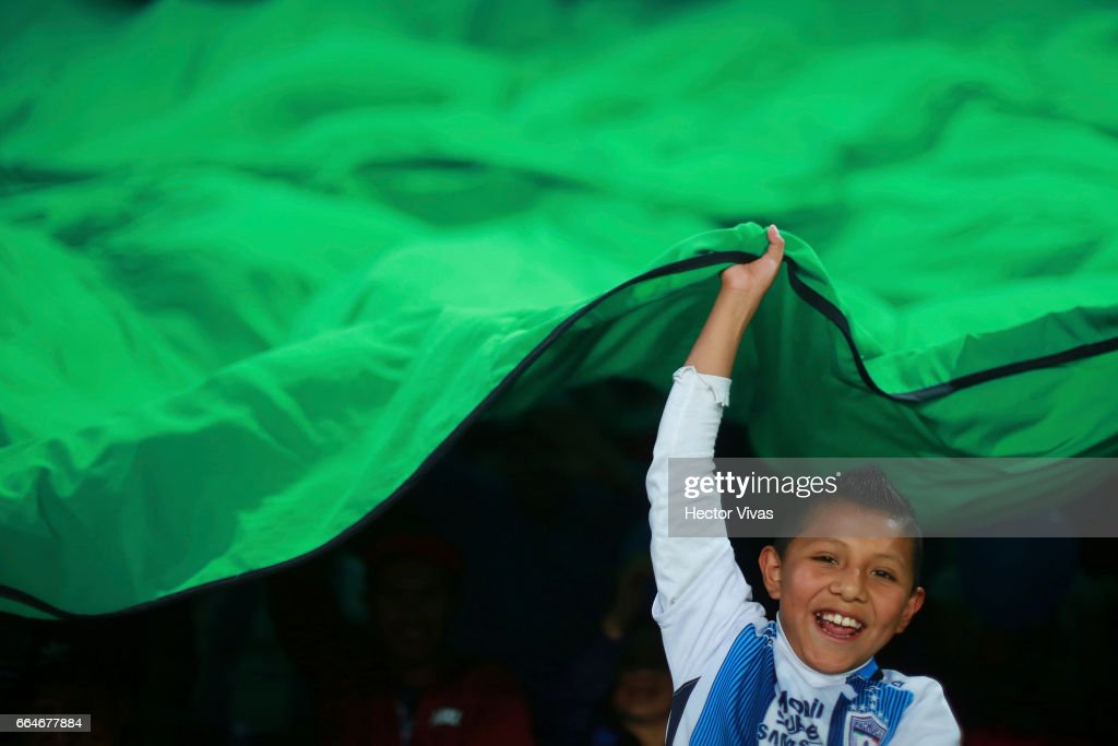 A fan of Pachuca smiles as he holds a big flag during the semifinals second leg match between Pachuca and FC Dallas as part of the CONCACAF Champions League 2017 at Hidalgo Stadium on April 04, 2017 in Pachuca, Mexico.