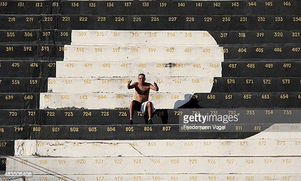 A fan of Ponte Preta reacts during the match between Ponte Preta and Flamengo for the Brazilian Series A 2015 at Moises Lucarelli Stadium on August 9...
