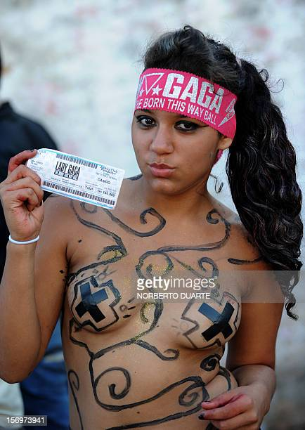 A fan of pop diva Lady Gaga currently on tour in South America shows her ticket as she queues waiting to get inside the venue for the show the singer...