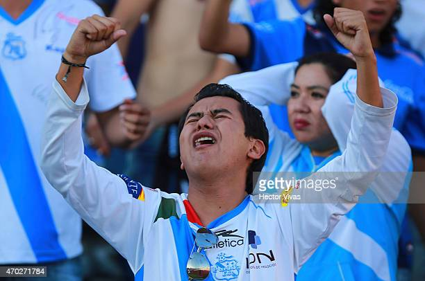 A fan of Puebla cries during a match between Puebla and Atlas as part of 14th round Clausura 2015 Liga MX at Olimpico Universitario BUAP Stadium on...