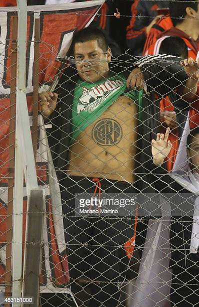A fan of River Plate shows his tatoo during a second leg final match between River Plate and Tigres UANL as part of Copa Bridgestone Libertadores...