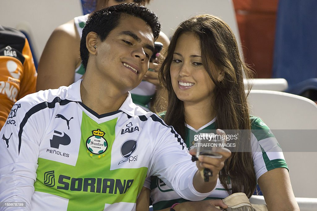 Fan of Santos support their team during a match between Atlante and Santos Laguna as part of the Apertura 2013 Liga MX at Olympic Stadium Andres Quintana Roo on October 26, 2013 in Cancun, Mexico.