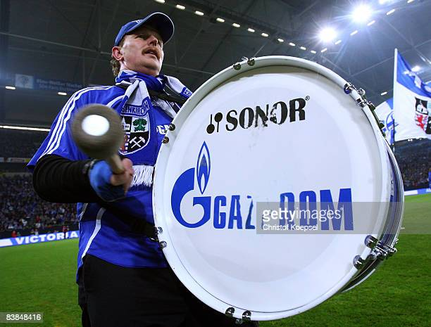 A fan of Schalke beats the drum during the UEFA Cup Group A match between FC Schalke 04 and Manchester City at the Veltins Arena on November 27 2008...
