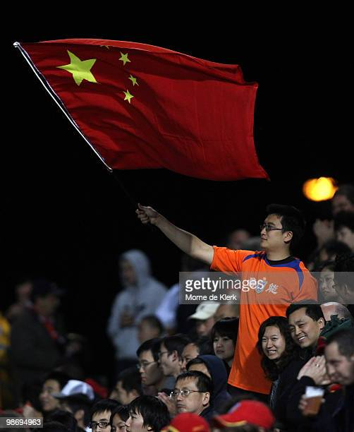 A fan of Shandong flies the Chinese flag in support of his team during the AFC Champions League Group H match between Adelaide United and Shandong...