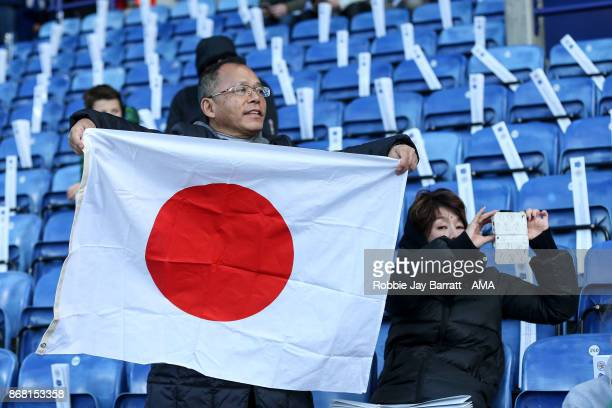 A fan of Shinji Okazaki of Leicester City holds up a Japan flag prior to the Premier League match between Leicester City and Everton at The King...
