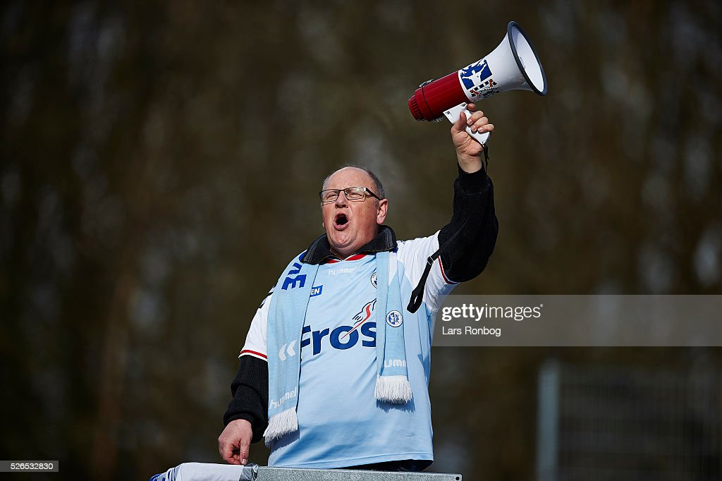 Fan of Sonderjyske cheer during the Danish Alka Superliga match between Hobro IK and Sonderjyske at DS Arena on April 30, 2016 in Hobro, Denmark.