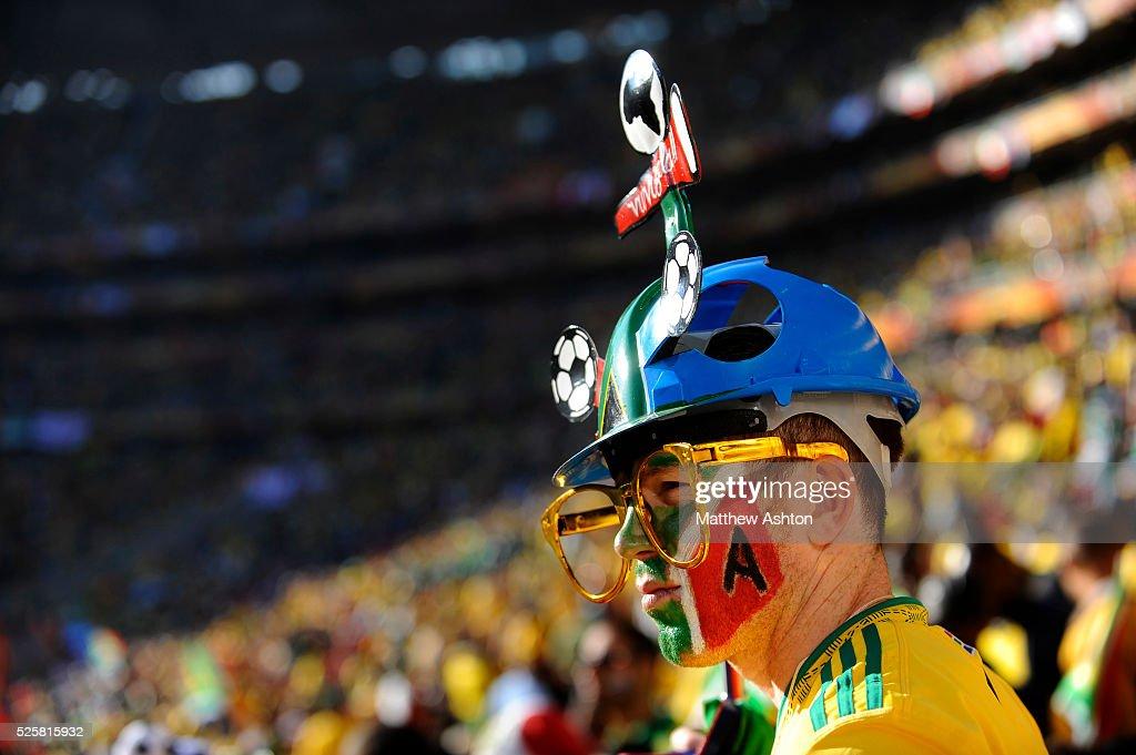 A fan of South Africa wearing a Makarapa hat