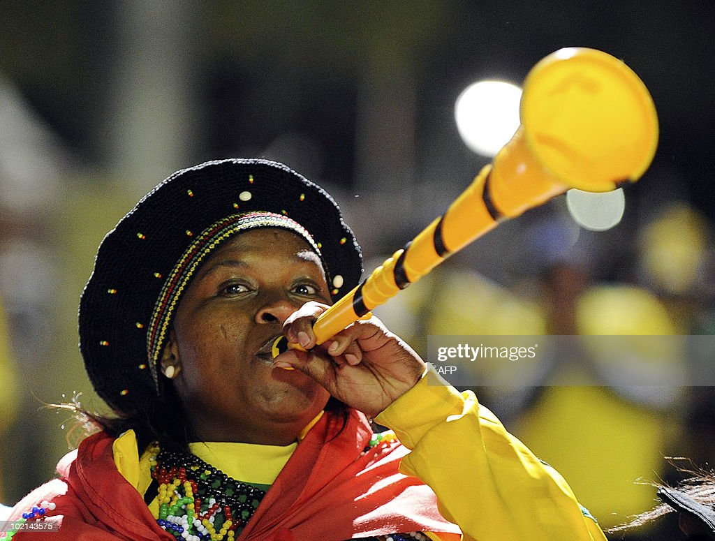 A fan of South Africa's football squad plays a vuvuzela as she arrives at Loftus Versfeld Stadium in Pretoria on June 16, 2010 to watch the 2010 World Cup match South Africa vs Uruguay. AFP PHOTO/Monirul Bhuiyan