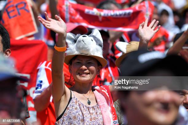 A fan of Sunwolves waves for players of Sunwolves during the Super Rugby match between the Sunwolves and the Blues at Prince Chichibu Stadium on July...