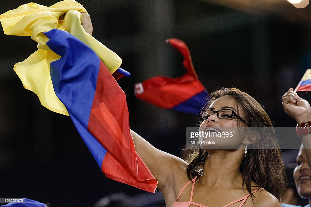 A Fan of Team Colombia waves a Colombian flag during Game 5 of the Qualifying Round of the World Baseball Classic between Team Panama and Team Colombia at Rod Carew National Stadium on Sunday, November18, 2012 in Panama City, Panama.