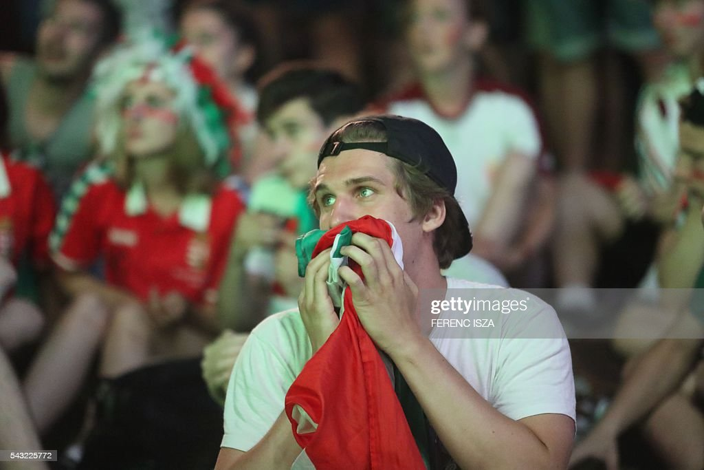 A fan of team Hungary reacts on June 26, 2016 in Budapest during the Euro 2016 football match against Belgium being played in Toulouse, France. Hungary lost 0-4. / AFP / Ferenc ISZA