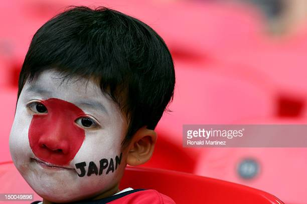 A fan of Team Japan smiles before Japan takes on the United States in the Women's Football gold medal match on Day 13 of the London 2012 Olympic...