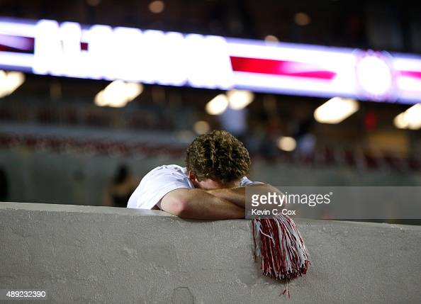 A fan of the Alabama Crimson Tide reacts after their 4337 loss to the Mississippi Rebels at BryantDenny Stadium on September 19 2015 in Tuscaloosa...