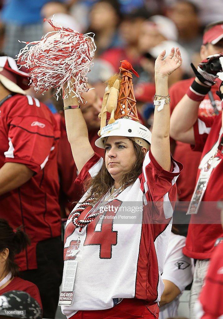 A fan of the Arizona Cardinals cheers during the NFL game against the Detroit Lions at the University of Phoenix Stadium on September 15, 2013 in Glendale, Arizona. The Carindals defeated the Lions 25-21.