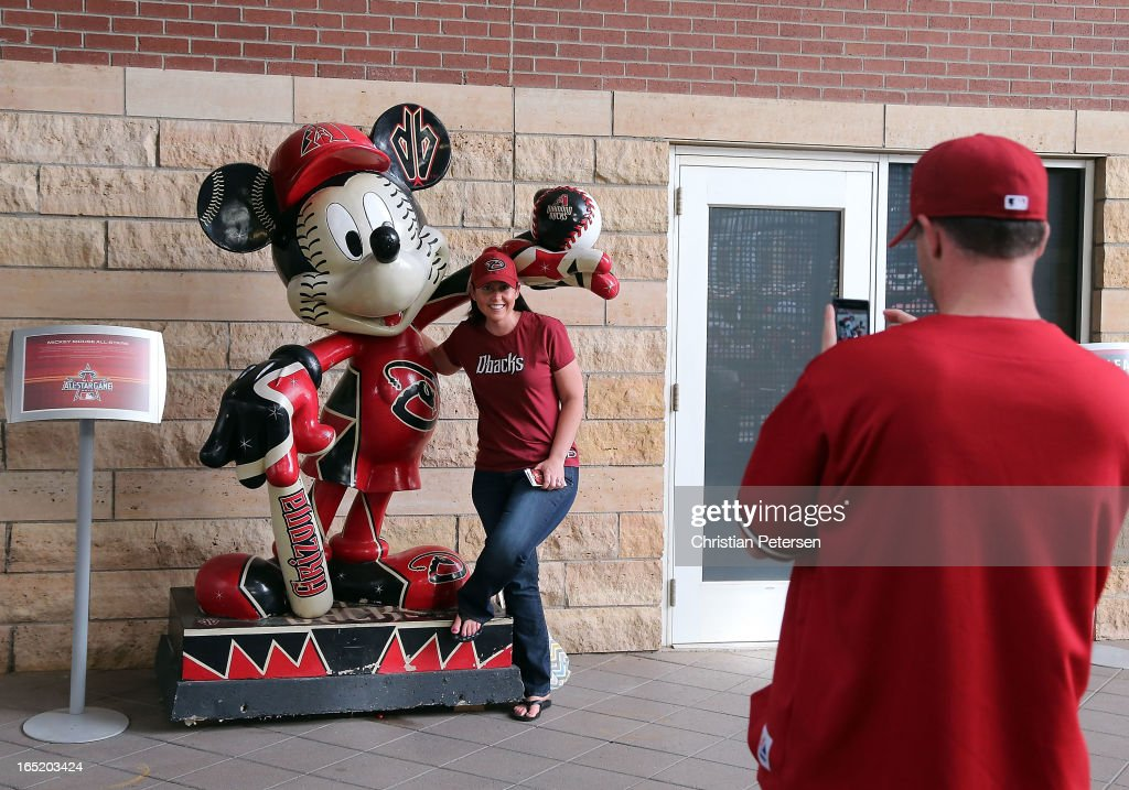 A fan of the Arizona Diamondbacks has her photo taken before the MLB Opening Day game against the St. Louis Cardinals at Chase Field on April 1, 2013 in Phoenix, Arizona.