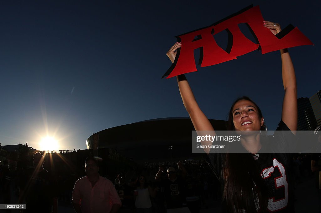 A fan of the Atlanta Falcons cheers for her team prior to a game against the New Orleans Saints at the Mercedes-Benz Superdome on October 15, 2015 in New Orleans, Louisiana.