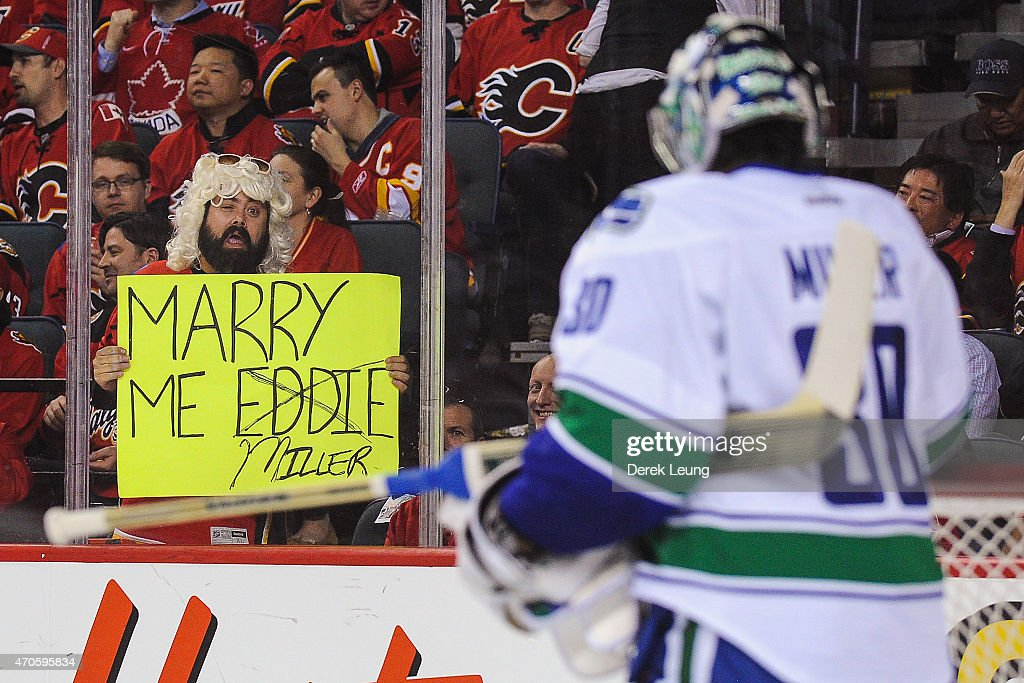 A fan of the Calgary Flames holds a sign for <a gi-track='captionPersonalityLinkClicked' href=/galleries/search?phrase=Ryan+Miller+-+Ice+Hockey+Player&family=editorial&specificpeople=206960 ng-click='$event.stopPropagation()'>Ryan Miller</a> #30 of the Vancouver Canucks in Game Four of the Western Quarterfinals during the 2015 NHL Stanley Cup Playoffs at Scotiabank Saddledome on April 21, 2015 in Calgary, Alberta, Canada. The Flames defeated the Canucks 3-1.