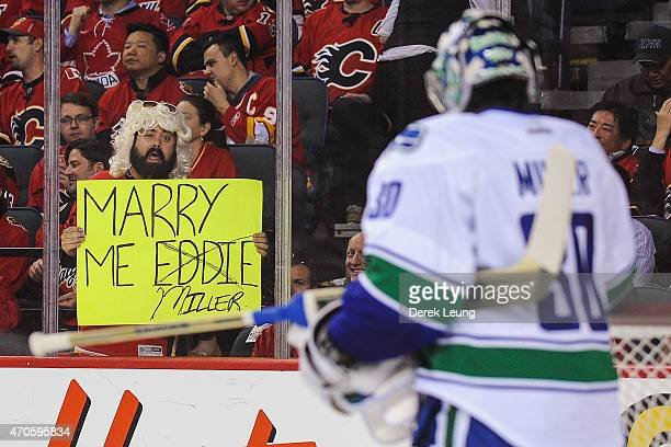 A fan of the Calgary Flames holds a sign for Ryan Miller of the Vancouver Canucks in Game Four of the Western Quarterfinals during the 2015 NHL...