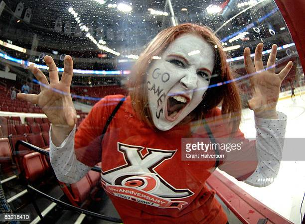 A fan of the Carolina Hurricanes waits for the team to arrive before a game against the Florida Panthers at the RBC Center on October 10 2008 in...