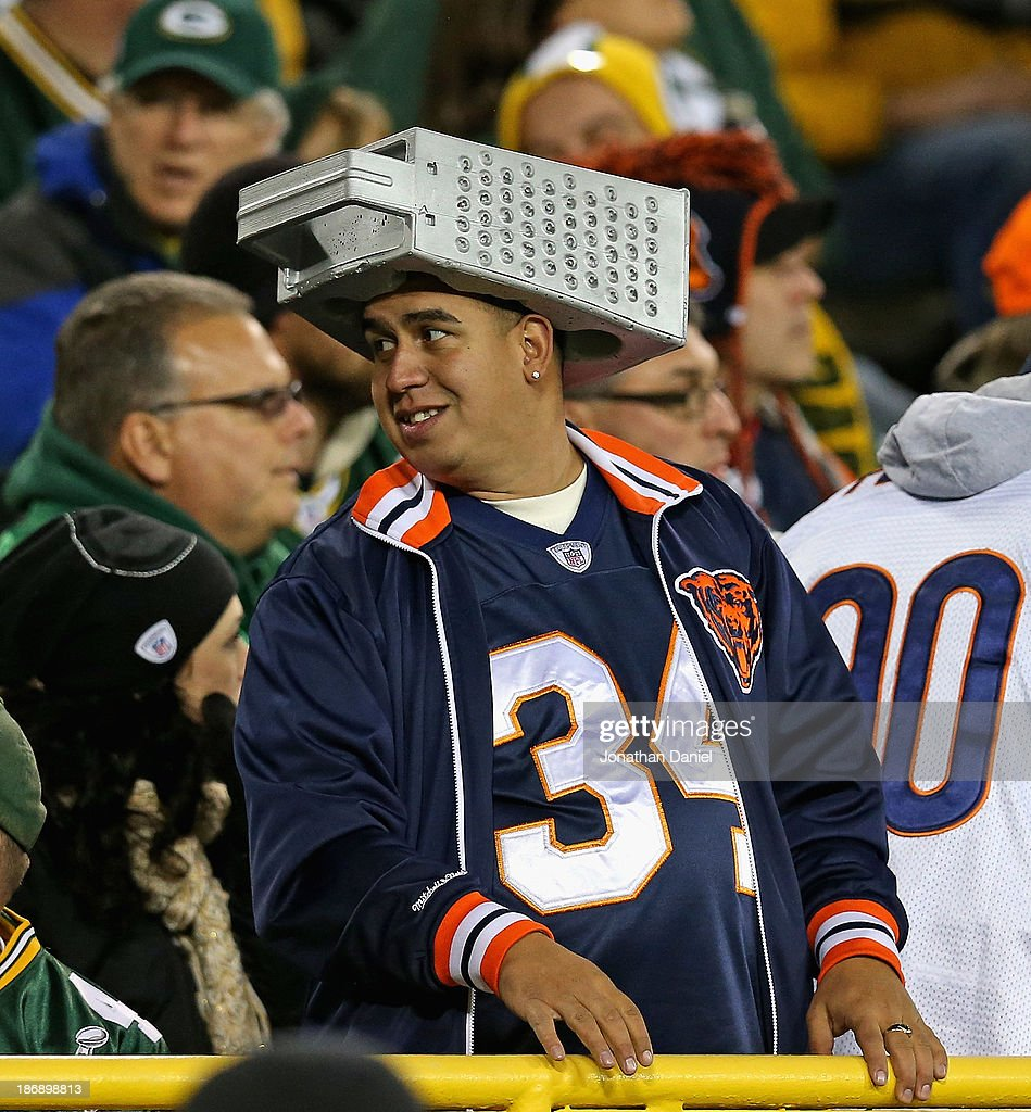 A fan of the Chicago Bears wears a cheese grader on his head during a game between the Bears and the Green Bay Packers at Lambeau Field on November 4, 2013 in Green Bay, Wisconsin.