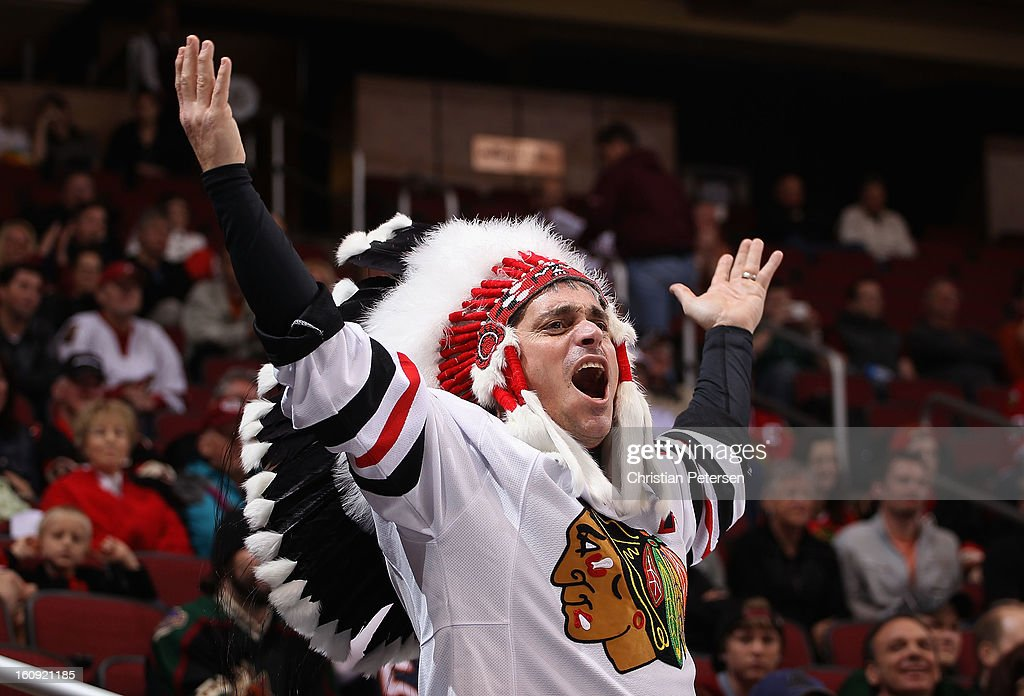 A fan of the Chicago Blackhawks cheers during the NHL game against the Phoenix Coyotes at Jobing.com Arena on February 7, 2013 in Glendale, Arizona. The Blackhawks defeated the Coyotes 6-2.