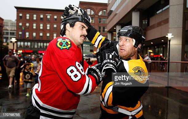 A fan of the Chicago Blackhawks squares off with s Boston Bruins fan outside of the arena prior to Game Three of the NHL 2013 Stanley Cup Final at TD...