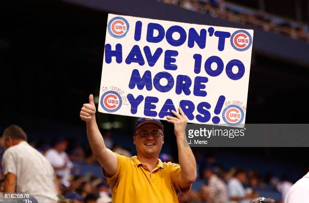 A fan of the Chicago Cubs holds a sign during the game against the Tampa Bay Rays during the game at Tropicana Field June 18 2008 in St Petersburg...