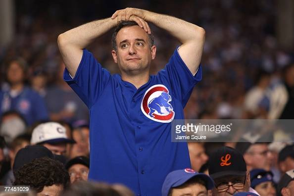 A fan of the Chicago Cubs looks on dejected against the Arizona Diamondbacks during Game Three of the National League Divisional Series at Wrigley...