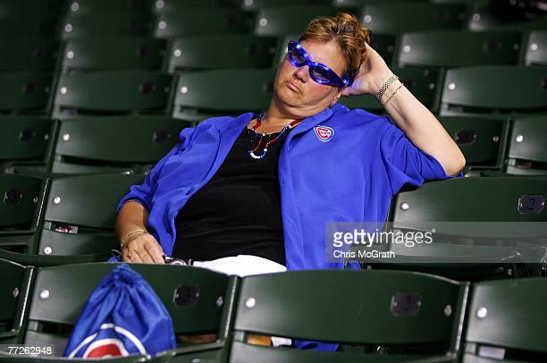 A fan of the Chicago Cubs sits in the stands dejected after the Cubs lost 51 against the Arizona Diamondbacks during Game Three of the National...