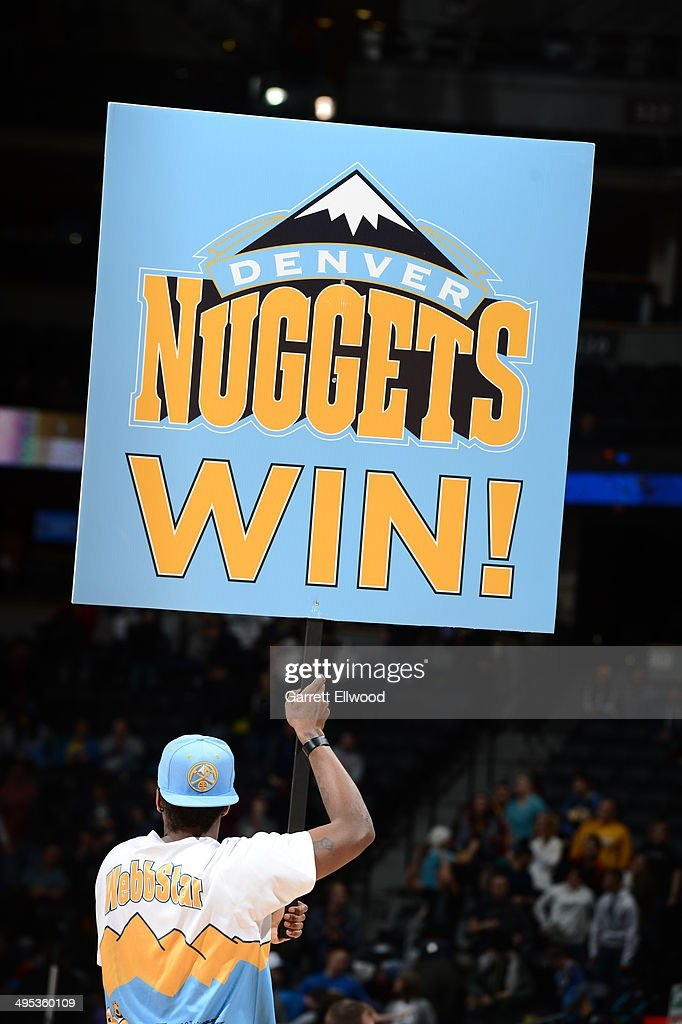 A fan of the Denver Nuggets holds up a 'Nuggets Win' sign during the game against the Milwaukee Bucks on February 5, 2014 at the Pepsi Center in Denver, Colorado.