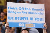 A fan of the Denver Nuggets holds up a sign against the New Orleans Hornets during Game Five of the Western Conference Quarterfinals during the 2009...