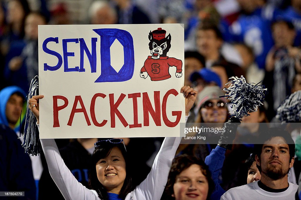 A fan of the Duke Blue Devils holds a sign that reads 'SEND PACKING' during a game against the North Carolina State Wolfpack at Wallace Wade Stadium on November 9, 2013 in Durham, North Carolina. Duke defeated NC State 38-20.