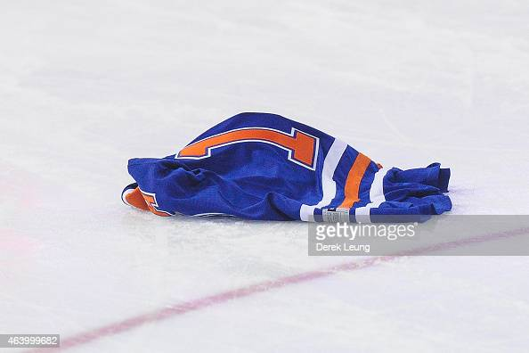 A fan of the Edmonton Oilers throws his jersey onto the ice during an NHL game against the Minnesota Wild at Rexall Place on February 20 2015 in...