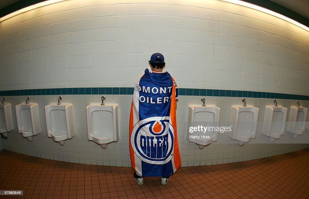 A fan of the Edmonton Oilers uses a urinal before the game between the San Jose Sharks and Edmonton Oilers in game three of the Western Conference...