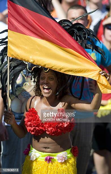 BLN095 A fan of the German national football team celebrates with a German flag during a public viewing in Dresden eastern Germany on July 3 2010 of...