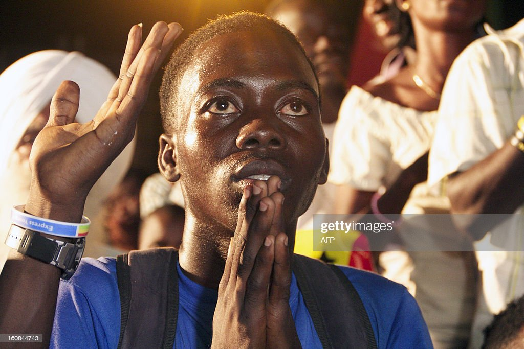A fan of the Ghana football team prays during a penalty shootout in the semi-final match of the Africa Cup of Nations between Ghana and Burkina Faso on February 6, 2013 in Accra. Rank outsiders Burkina Faso will face Nigeria in the Africa Cup of Nations final after a 3-2 penalty shootout win over Ghana. AFP PHOTO/Chris Stein
