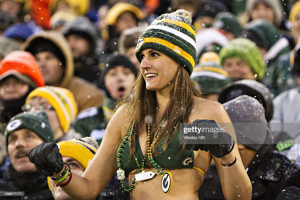 Fan of the Green Bay Packers dances in the snow in her bathing suit during a game against the Pittsburgh Steelers at Lambeau Field on December 22, 2013 in Green Bay, Wisconsin.