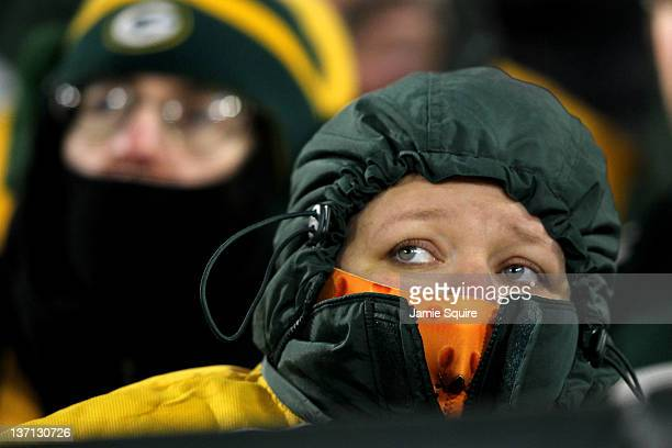 A fan of the Green Bay Packers looks on towards the end of the game against the New York Giants during their NFC Divisional playoff game at Lambeau...