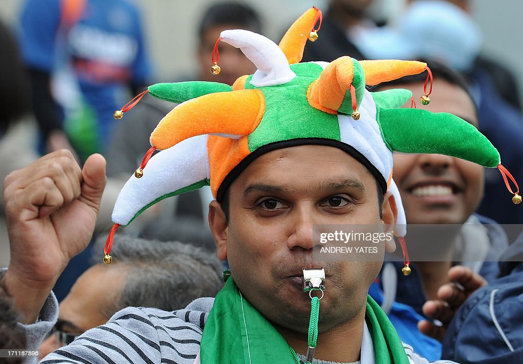 A fan of the Indian cricket team, wearing a hat in the team colours and blowing a whistle waits for the start of the 2013 ICC Champions Trophy Final cricket match between England and India at Edgbaston in Birmingham, central England on June 23, 2013.
