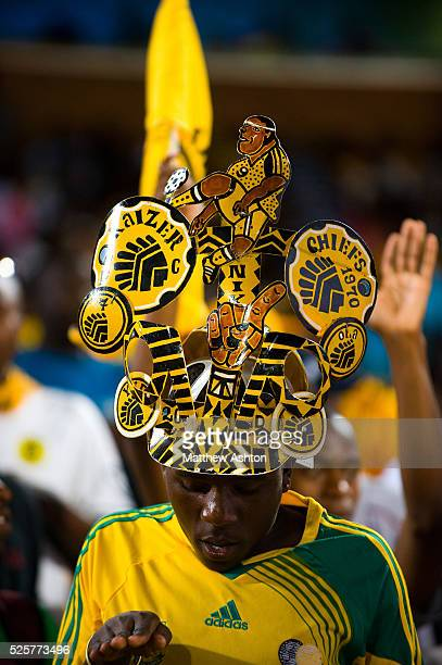 A fan of the Kaizer Chiefs wearing a makarapa a customised miner's hard hat / fan helmet
