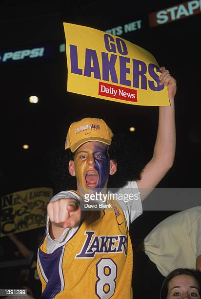 A fan of the Los Angeles Lakers holds up a sign of support and yells at the camera during Game Two of the 2002 NBA Finals against the New Jersey Nets...