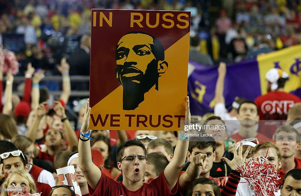 A fan of the Louisville Cardinals holds up a sign which reads 'In Russ we trust' in support of Russ Smith #2 of the Louisville Cardinals against the Michigan Wolverines during the 2013 NCAA Men's Final Four Championship at the Georgia Dome on April 8, 2013 in Atlanta, Georgia.